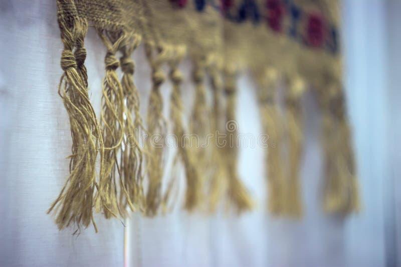Cordes du tissu de toile sur le mur images stock