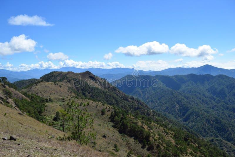 Mount Ulap, mt Ulap, Cordilleras mountain ranges, Ampucao mountain ranges, Ampucao, Itogon, Benguet, Philippines. Cordillera Mountain Range, viewed at High Noon royalty free stock photo