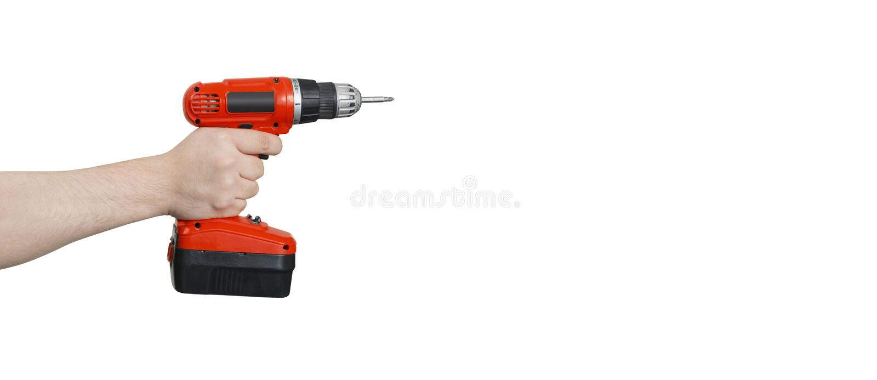 Cordless śrubokręt w ręce z ścinku klepnięciem lub obrazy stock