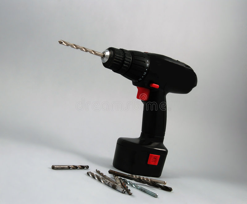 Cordless Drill. Cordless electric power drill with bits stock photography