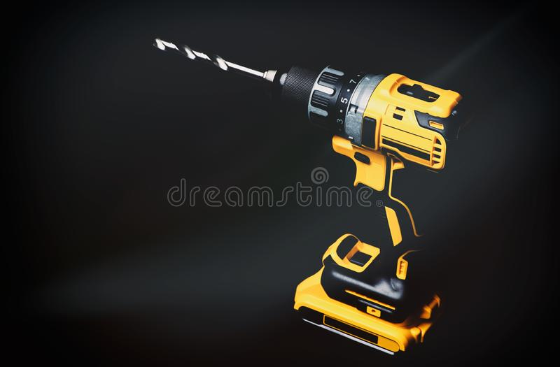 cordless drill and a drill on a black background stock photos