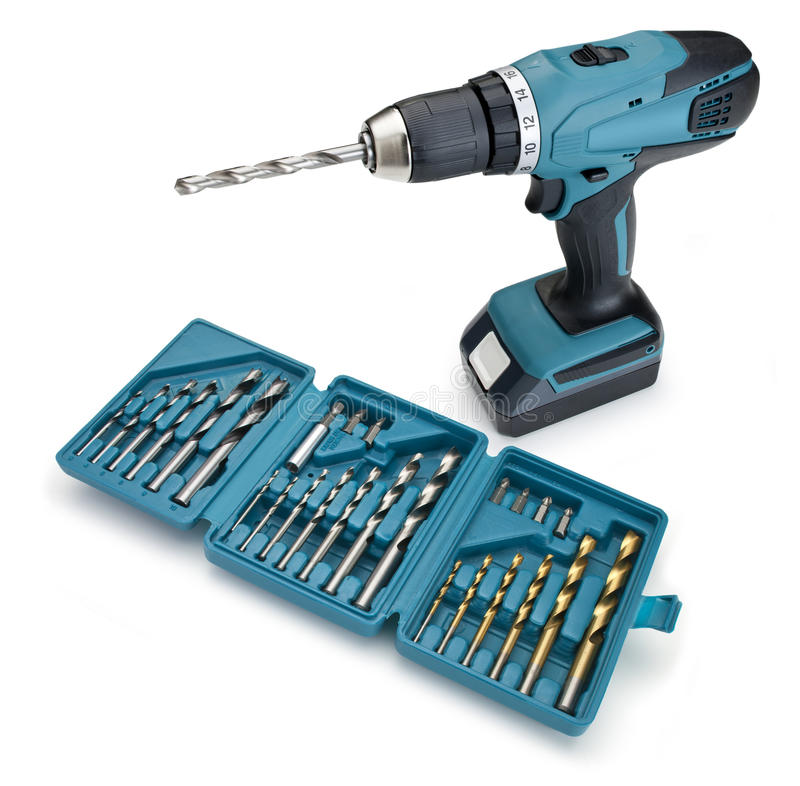 Cordless Drill And Drill Bits. A cordless electric drill with a box of drill bits on a white background royalty free stock image