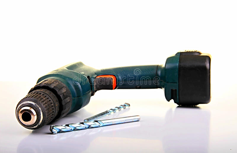 Cordless drill power tool. Image of a cordless electric drill with a large drill bit sitting on a table top royalty free stock image