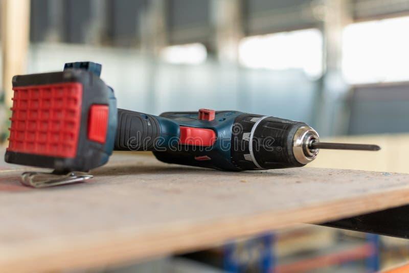 Cordless drill, screwdriver, construction. Cordless drill, screwdriver, on scaffolding stock photos