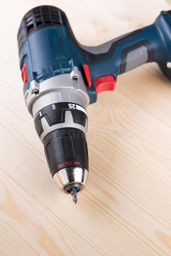 Cordless drill on the wooden board table stock photos