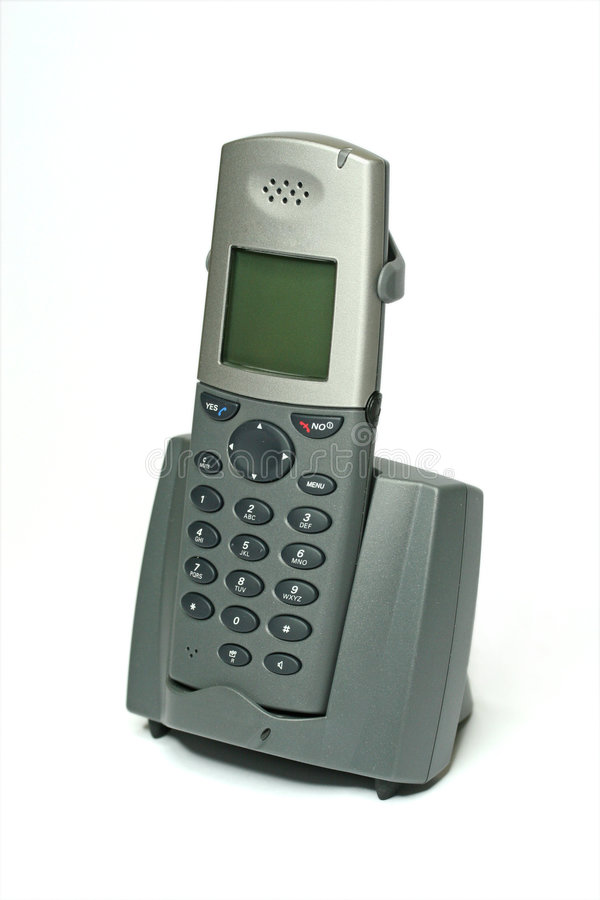 Cordless Phone with Cradle on White. Business, buttons, call, cell, cellular, charger, closeup, communication, connection, cordless, cradle, dect, device, dial stock images