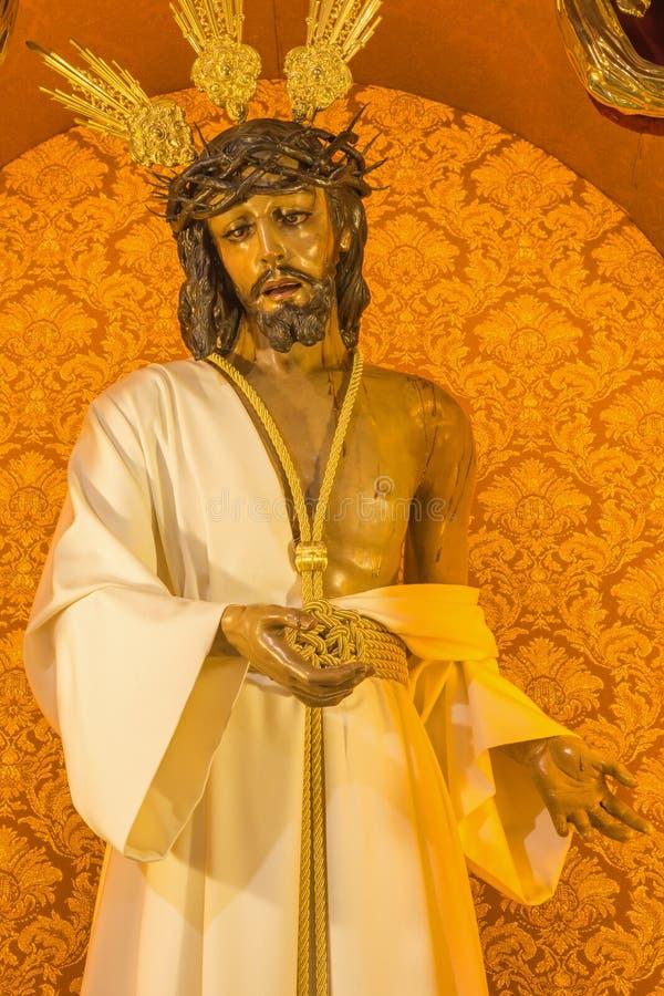 Cordoba - типично статуя vestet (Иисуса Христоса Nuestro Padre de Ла Humildad) в церков Convento de Capuchinos стоковое изображение rf