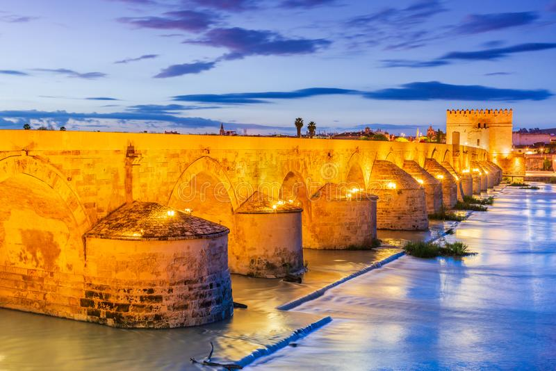 Cordoba, Andalusia, Spain - Puente Romano. Cordoba, Andalusia, Spain. Puente Romano, Guadalquivir river and Calahorra Tower at sundown royalty free stock photography