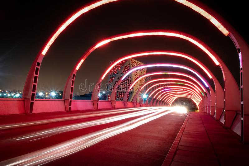 Puente del Bicentenario at night with Centro Cívico del Bicentenario on background - Cordoba, Argentina. Cordoba, Argentina - May 7, 2018: Puente del royalty free stock image