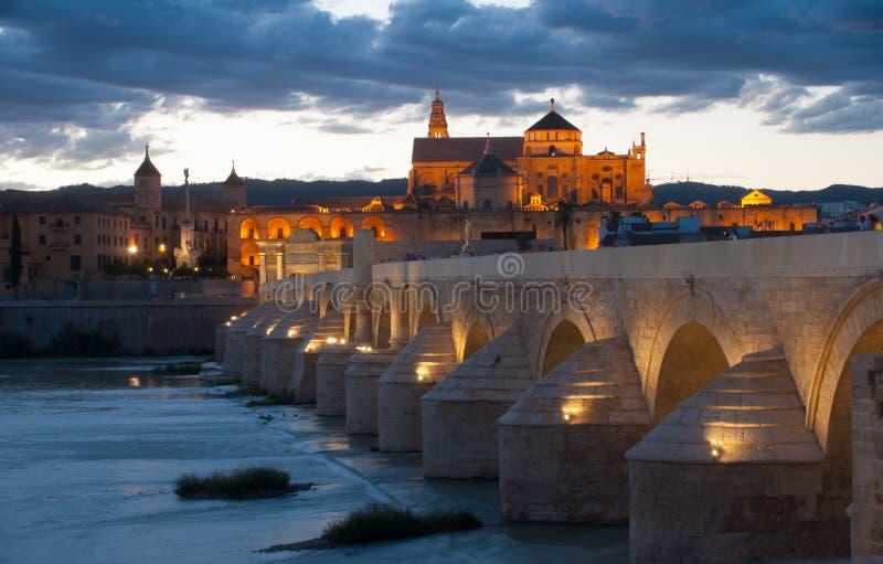 Cordoba at dawn. The mezquita and the roman bridge of cordoba in spain stock image