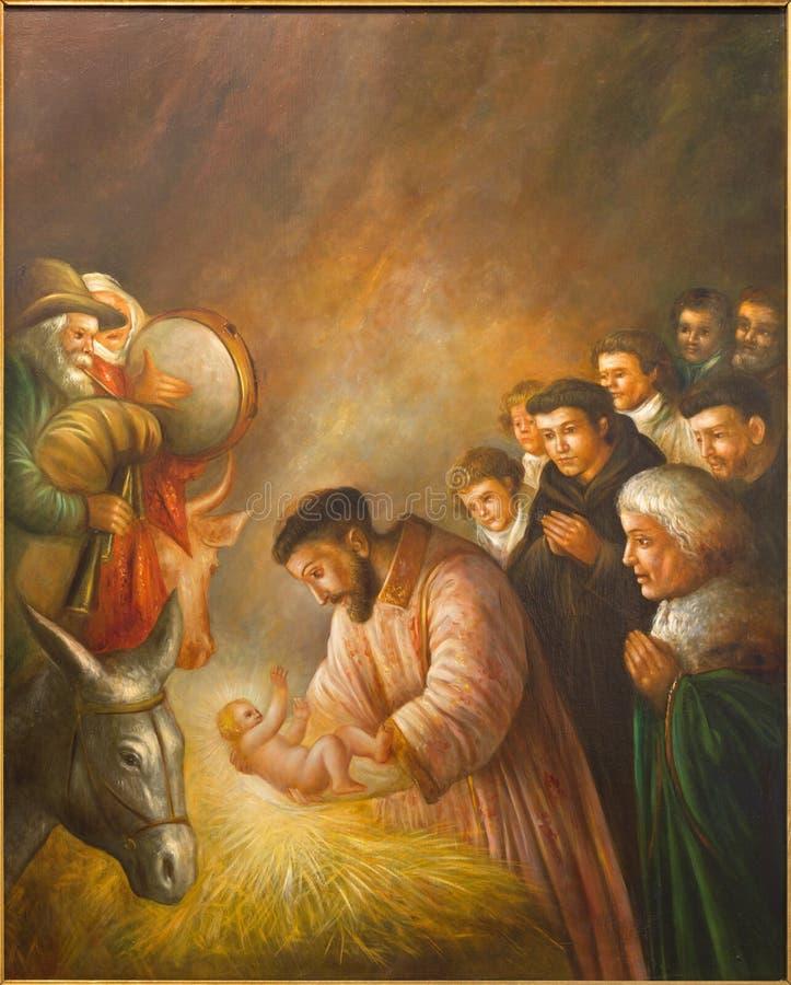 Cordoba - de moderne verf van st Francis van Assisi in de scène van Geboorte van Christus door onbekende kunstenaar van 20 cent i stock foto