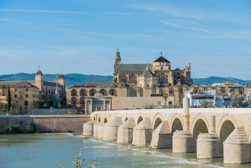 Roman bridge in Cordoba, Andalusia, southern Spain. CORDOBA, ES - NOVEMBER 01, 2013: The Roman bridge, built in the early 1st century BC across the Guadalquivir stock photography