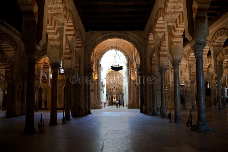 Cordoba Mosque interiors. Arches and columns stock photography