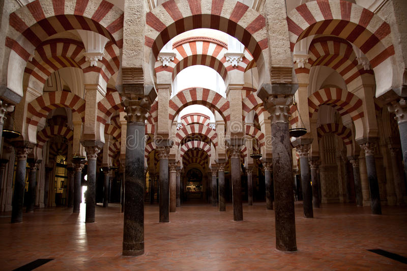 Cordoba Mosque interiors. Arches and columns royalty free stock photography