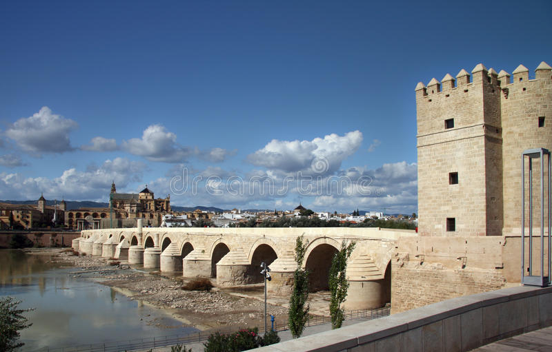 Cordoba, roman bridge and Calahorra Tower. A panoramic view of the Spanish city of Cordoba, on the foreground the medieval arabian tower Calahorra, the roman royalty free stock photos