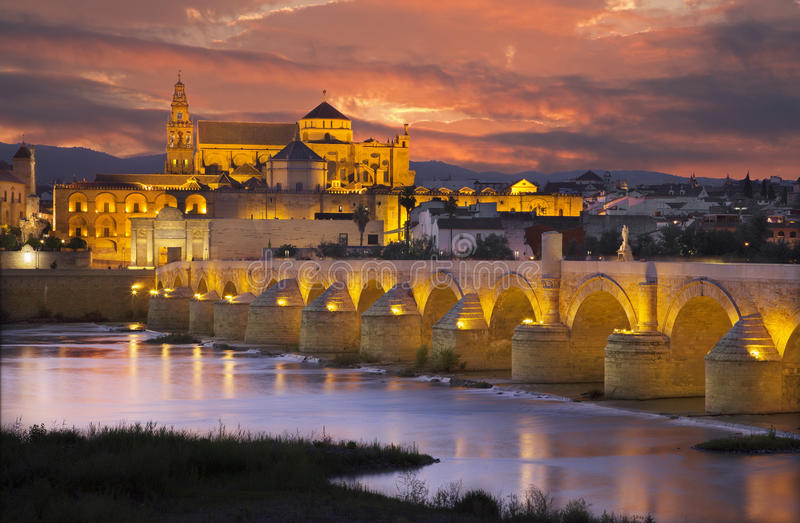 Cordoba - The Roman bridge and the Cathedral in the background royalty free stock image
