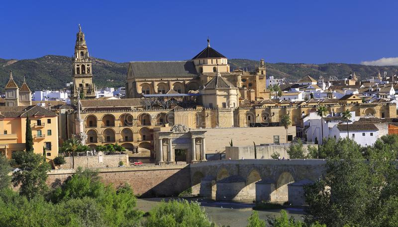 The Roman Bridge and Mosque Cathedral on the Guadalquivir River in Cordoba stock photography