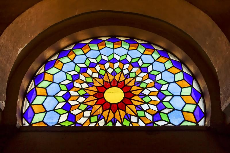 Beautiful stained glass window inside Mosque-Cathedral of Cordoba. Cordoba, Spain - Dec 2018: Beautiful colored stained glass window inside Mosque-Cathedral of stock images
