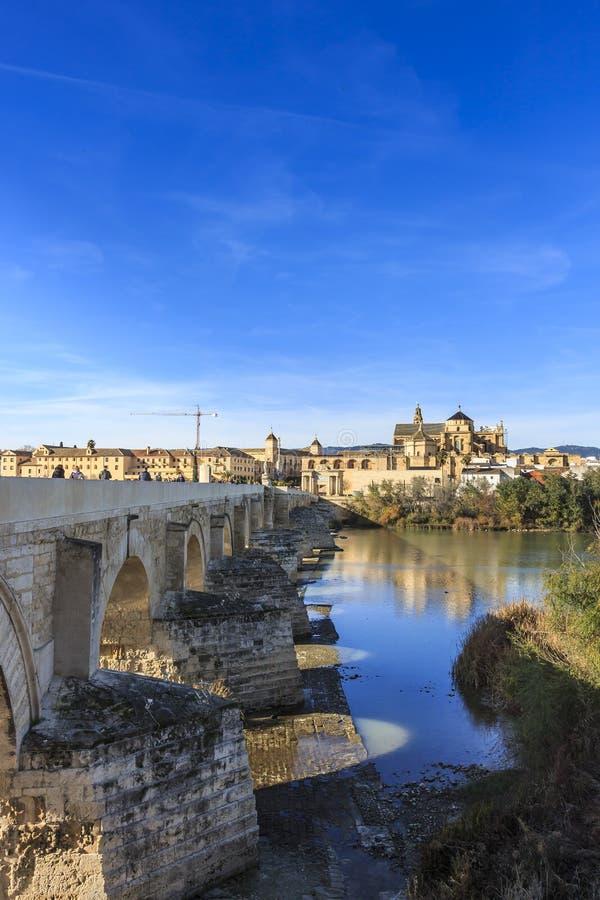Roman bridge of Cordoba bridges over the river Guadalquivir stock photography