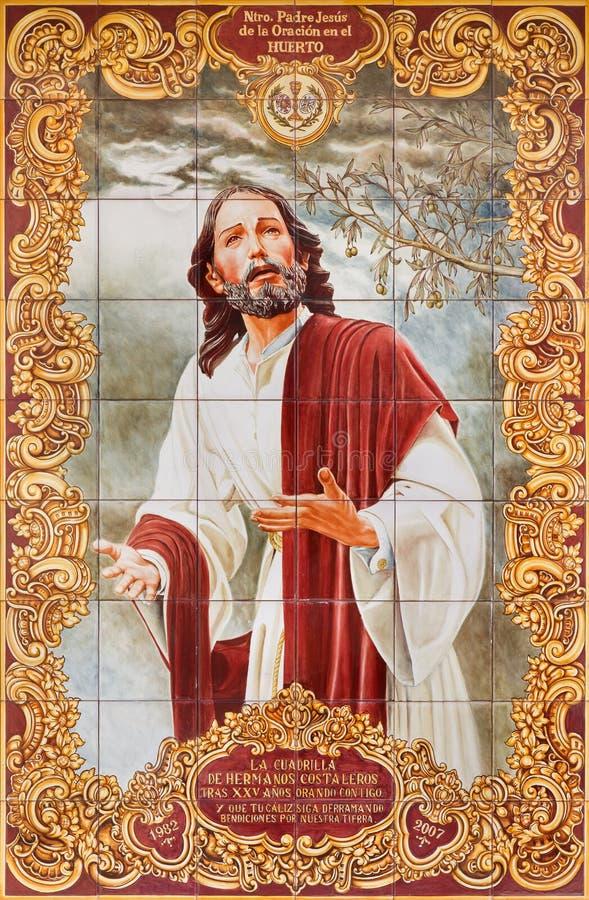 CORDOBA, SPAIN - MAY 26, 2015: : The ceramic tiled, cried Madonn. Cordoba - The ceramic tiled, cried Madonna on the facade of house on the Compas de San stock image