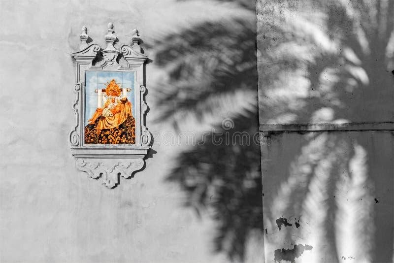 CORDOBA, SPAIN - MAY 26, 2015: The ceramic tiled Pieta on the facade of church Iglesia de San Augustin by artist Mensaque stock photography