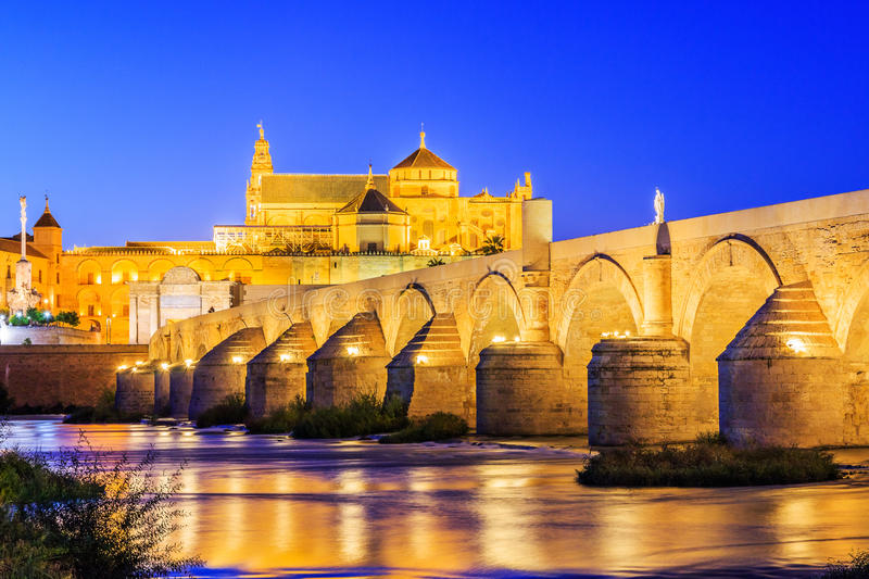 Cordoba, Spain. Roman Bridge on Guadalquivir river and Mezquita Cathedral royalty free stock photos
