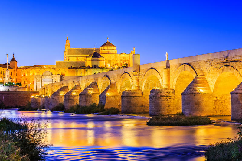 Cordoba, Spain. Roman Bridge and Mezquita Great Mosque Cathedral on the Guadalquivir River royalty free stock images