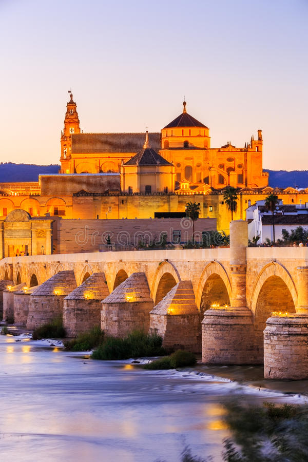 Cordoba, Spain. Roman Bridge and Mezquita Great Mosque Cathedral on the Guadalquivir River royalty free stock photo