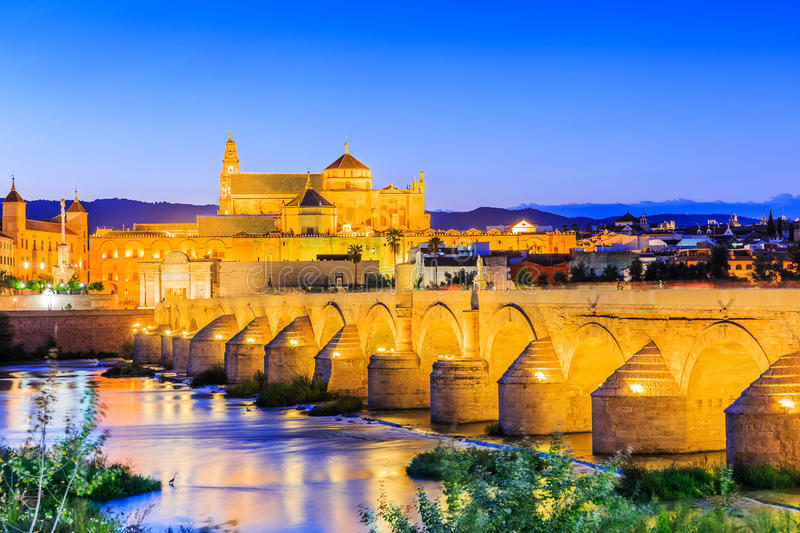 Cordoba, Spain. The Roman Bridge and Mosque Cathedral on the Guadalquivir River stock images