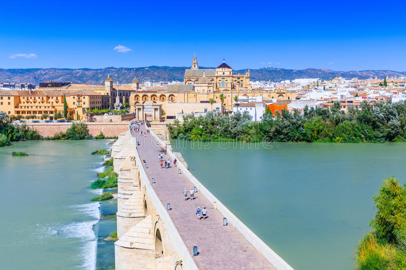 Cordoba, Spain. The Roman Bridge and Mosque Cathedral on the Guadalquivir River royalty free stock image