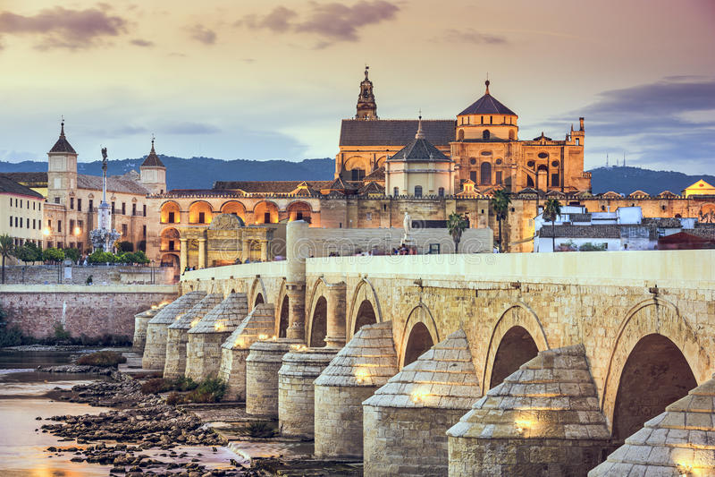 Cordoba, Spain at the Roman Bridge and Mosque-Cathedral. Cordoba, Spain view of the Roman Bridge and Mosque-Cathedral on the Guadalquivir River royalty free stock image