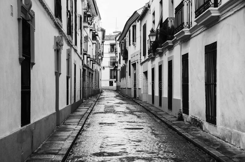 Streets of old city in Andalusia. Quiet empty street in Cordoba, Spain. Black and white stock image