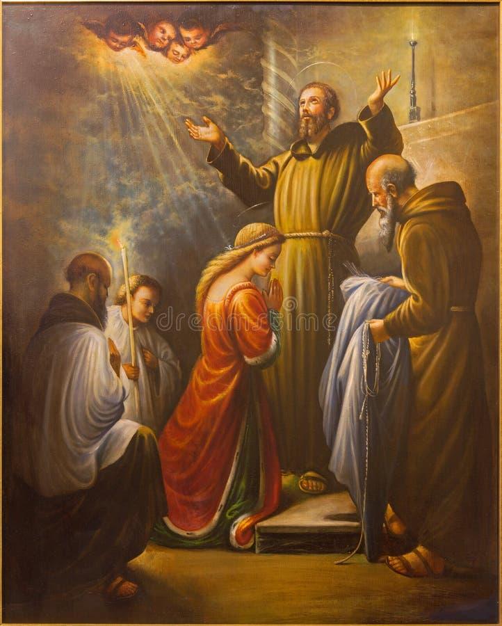 Cordoba - St Francis av Assisi på prästvigningen av st Clara i året 1212 i kyrkliga Convento de Capuchinos royaltyfri foto