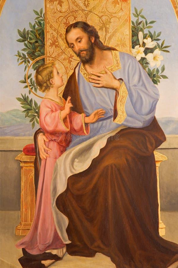 Cordoba - Verf van St Joseph van jaar 1909 door R Perea in kerk Convento DE Capuchinos stock afbeeldingen