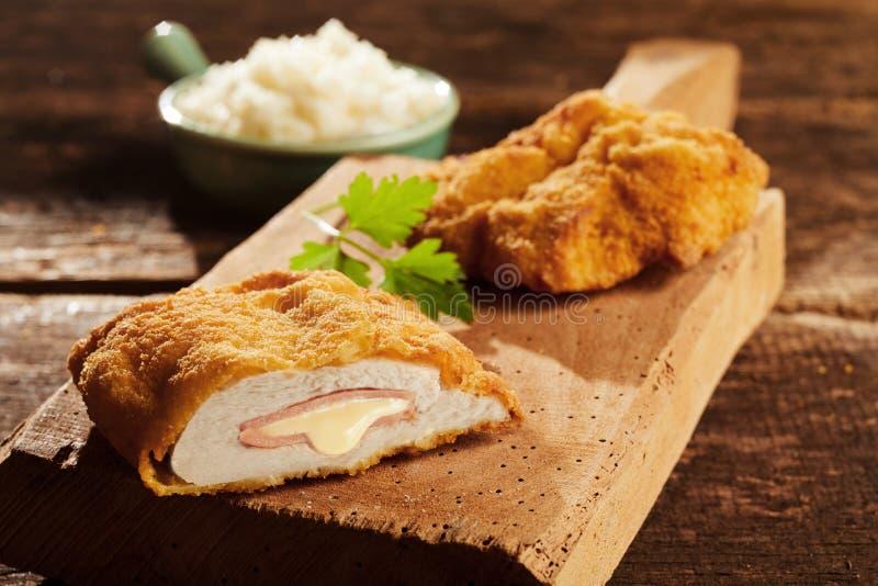 Cordon bleu chicken on cutting board stock photography