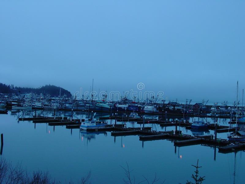 Cordova Alaska boats in winter. Cordova Alaska harbor in winter, misty early morning boats in slips stock photography