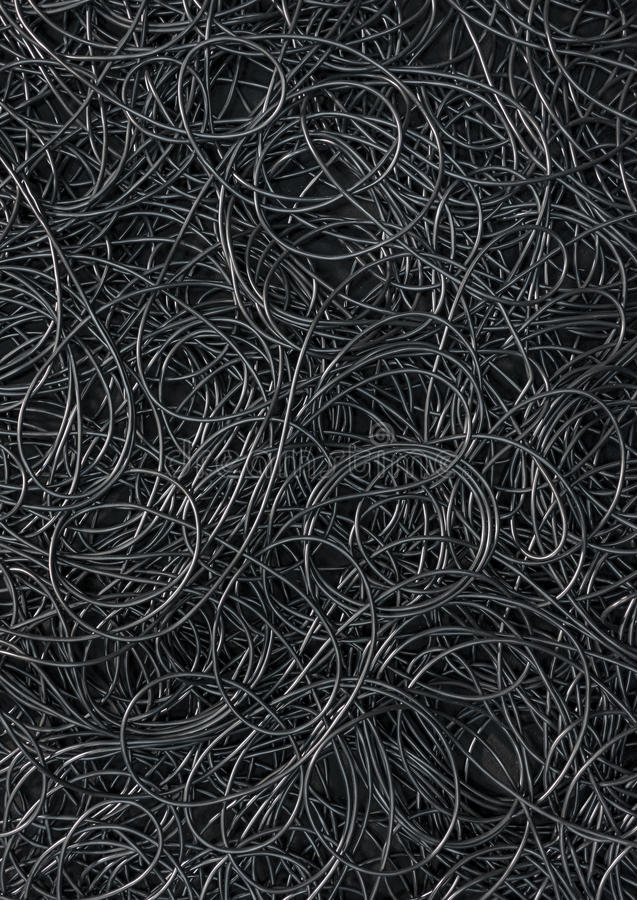Cords background. Background covered with a pile of electric cords filling the entire frame stock photo