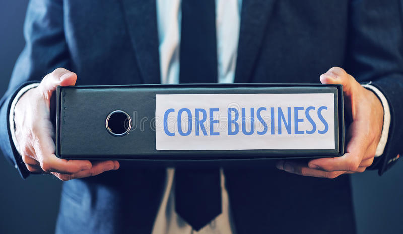 Core business with businessman and document ring binder stock images