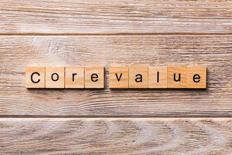 CORE VALUE word written on wood block. CORE VALUES text on wooden table for your desing, concept.  stock image