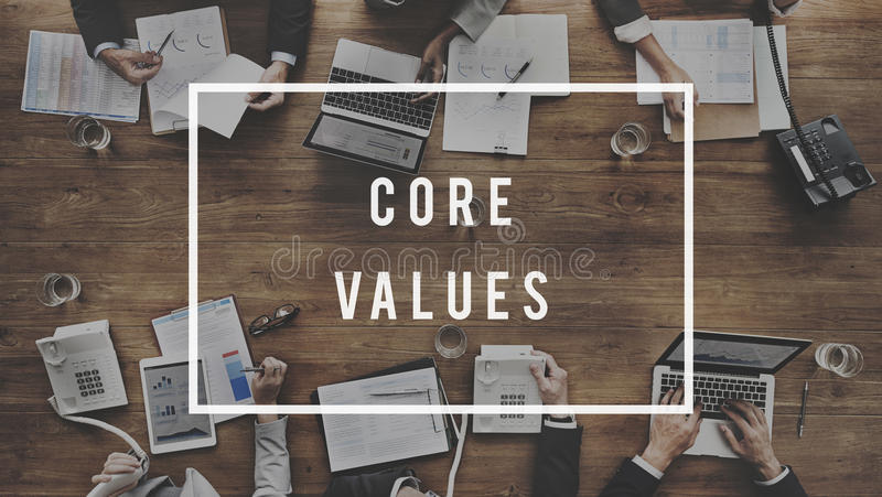 Core Values Principles Morals Concept. Diverse business people meeting core values word laptop tablet on table stock photo