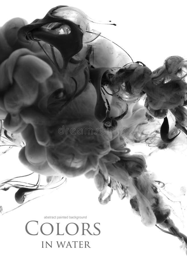 Cores acrílicas na água abstraia o fundo fotografia de stock royalty free