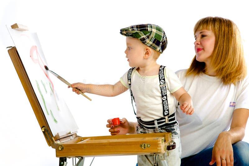Cores da pintura da mamã e do filho fotografia de stock