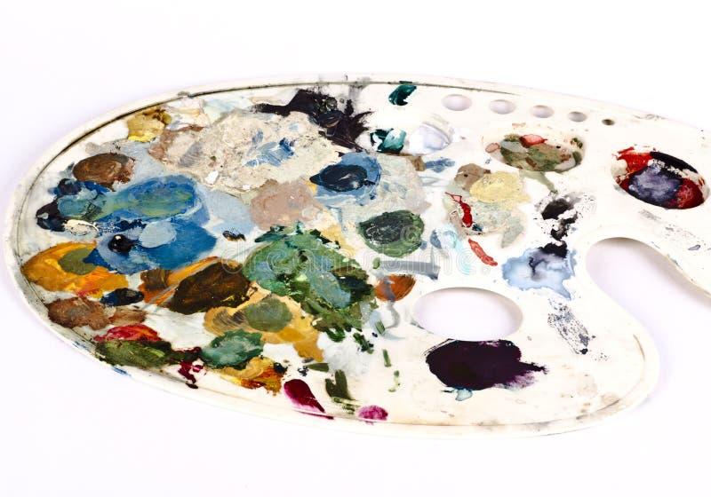 Cores secas sortidos em uma paleta dos pintores fotografia de stock royalty free