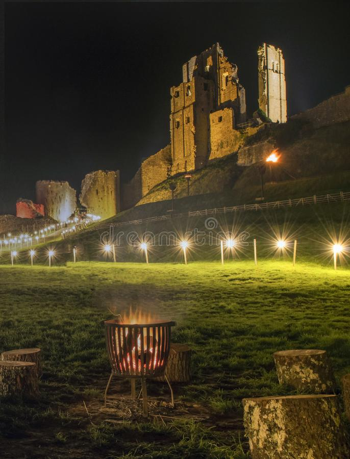 Corfe castle illuminated at night stock image