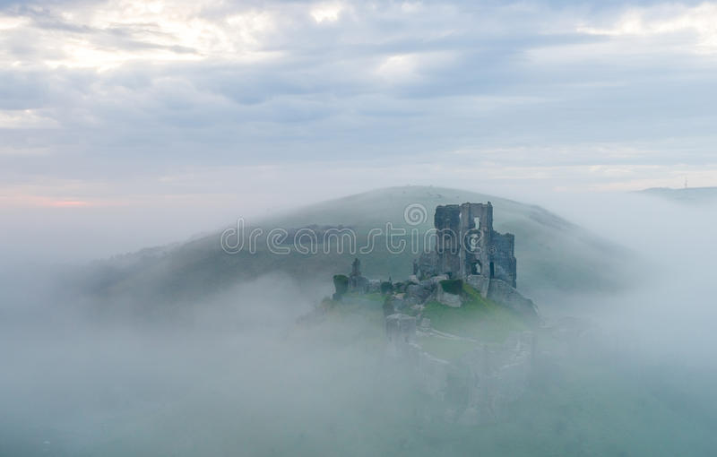 Corfe castle on a misty morning. Corfe castle ancient Dorset castle on misty winter morning stock photo