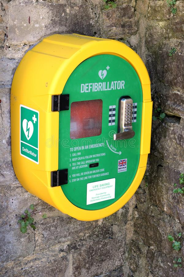 Corfe, Dorset, UK - Jun 03 2018: A publicly accessible automated external defibrillator AED on a stone wall, for emergency use i. N case of someone suffering stock images