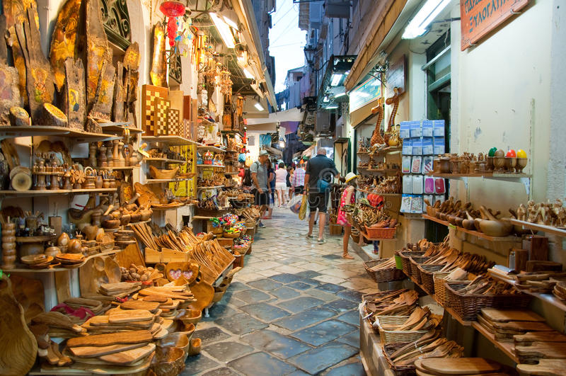 CORFU-AUGUST 24: Tourists go shopping in local souvenirs shops on August 24,2014 on Corfu island, Greece. stock images