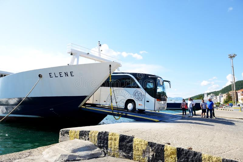 The Corfu ferry is in moorage and bus unloading. IGOUMENITSA, GREECE - MAY 17: The Corfu ferry is in moorage and bus unloading on May 17, 2016 in Igoumenitsa stock photos