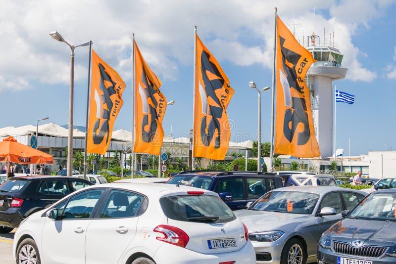 Corfu Grecja, Lipiec, -, 2018: Sixt czynsz samochodowy parking przy lotniskiem fotografia royalty free