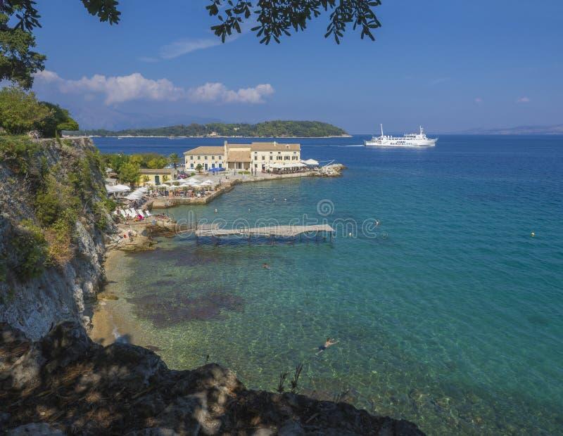 Corfu, Greece - June 7, 2017: Faliraki beach Alecos Baths public bathing spot with the En plo restaurant in Corfu Town, turquoise. Corfu, Greece - June 7, 2017 stock images